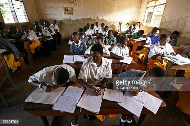 Students at St Denis' Secondary School in Ggaba a suburb of the capital Kampala study during the first lesson of the day 23 March 2007 The Ugandan...