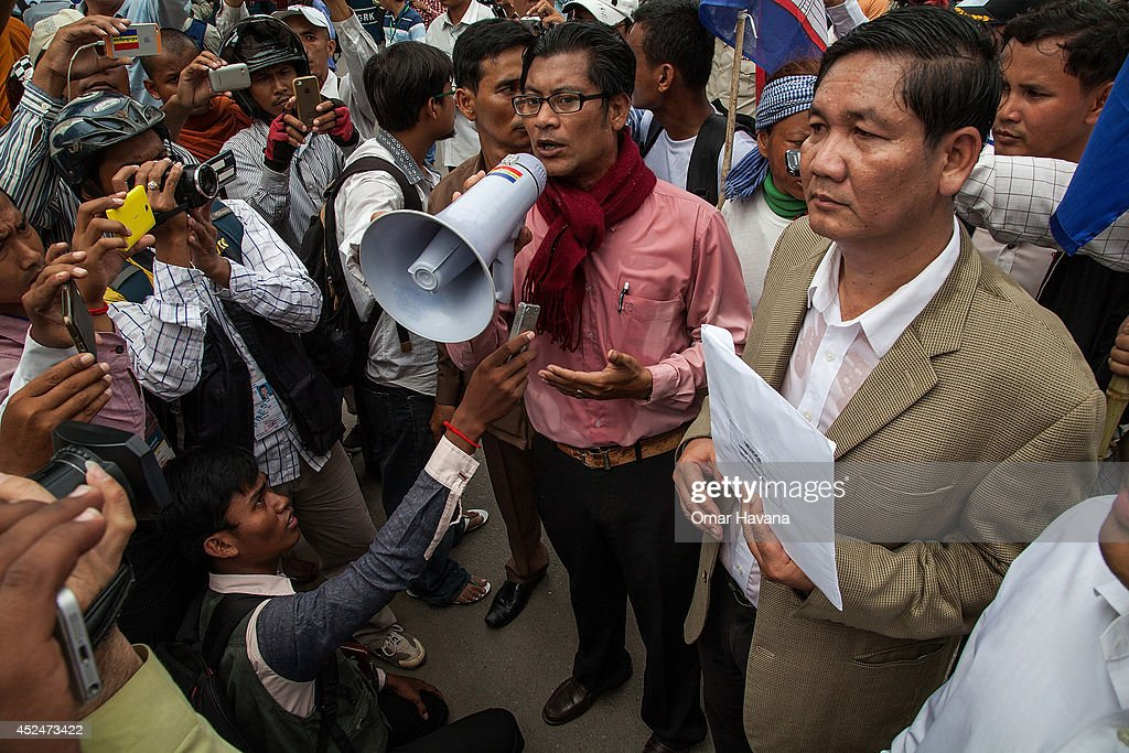 A Kampuchea Krom leader arrives at the office of the European Union's Permanent Mission to Cambodia to deliver a petition during a demonstration on July 21, 2014 in Phnom Penh, Cambodia. Thousands of protesters and monks march through the streets of Phnom Penh to deliver petitions to the French, British, American, Russian and Chinese embassies, before arriving at the Vietnamese Embassy. The protesters, organised by the Federation of Cambodian Intellectuals and Students (FCIS) and leaders of the Khmer Krom community, are demanding an apology from Vietnamese Embassy First Counsellor Tran Van Thong, who recently said that the former Kampuchea Krom provinces were held by Vietnam before their occupation by France. Ahead of the protest, Phnom Penh municipal authorities banned the protest, threatening the protesters who defied the ban could be jailed for up to 15 years.