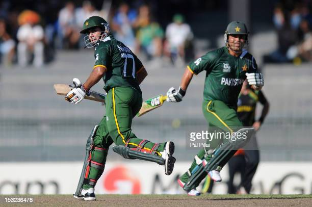 Kamran Akmal and Nasir Jamshed of Pakistan run between the wickets during the ICC World Twenty20 2012 Super Eights Group 2 match between Australia...