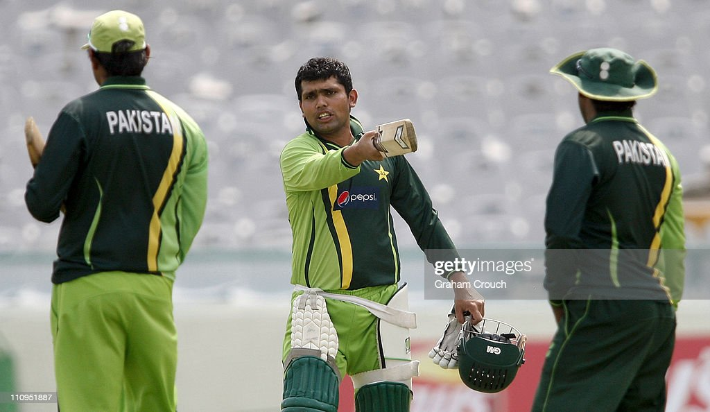 <a gi-track='captionPersonalityLinkClicked' href=/galleries/search?phrase=Kamran+Akmal&family=editorial&specificpeople=221679 ng-click='$event.stopPropagation()'>Kamran Akmal</a> (C) gestures during a Pakistan nets session at the Punjab Cricket Association Stadium on March 28, 2011 in Mohali, India. India will play Pakistan in the ICC World Cup Semi-Final on Wednesday.