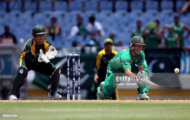 Kamran Akmal looks on as AB de Villiers of South Africa scores runs during the ICC World Twenty20 Super Eight match between Pakistan and South Africa...