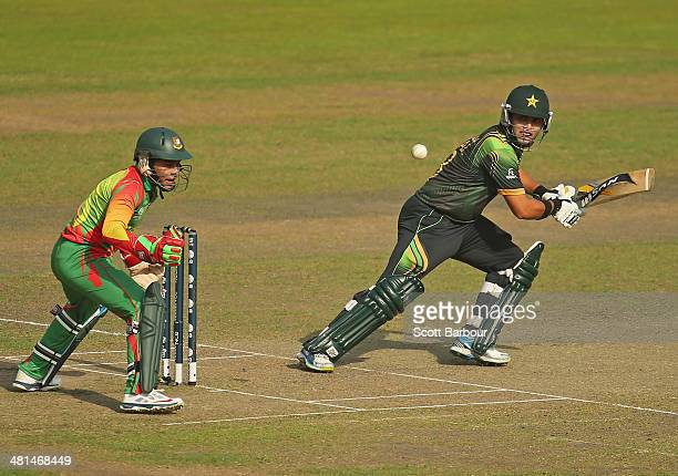 Kamran Akmal of Pakistan bats as Mushfiqur Rahim of Bangladesh looks on during the ICC World Twenty20 Bangladesh 2014 match between Pakistan and...