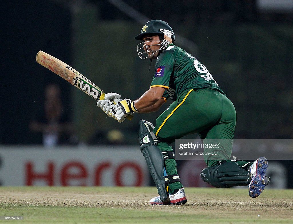 <a gi-track='captionPersonalityLinkClicked' href=/galleries/search?phrase=Kamran+Akmal&family=editorial&specificpeople=221679 ng-click='$event.stopPropagation()'>Kamran Akmal</a> of Pakistan bats during the Group D match between Pakistan and Bangladesh at Pallekele Cricket Stadium on September 25, 2012 in Kandy, Sri Lanka.