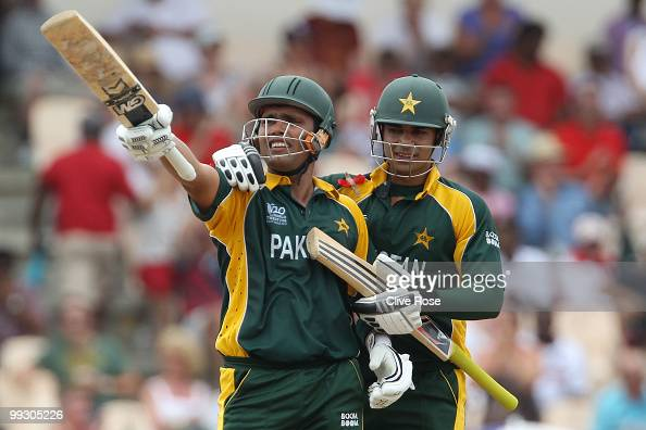 Kamran Akmal of Pakistan celebrates his half century with Salman Butt during the ICC World Twenty20 semi final between Australia and Pakistan at the...
