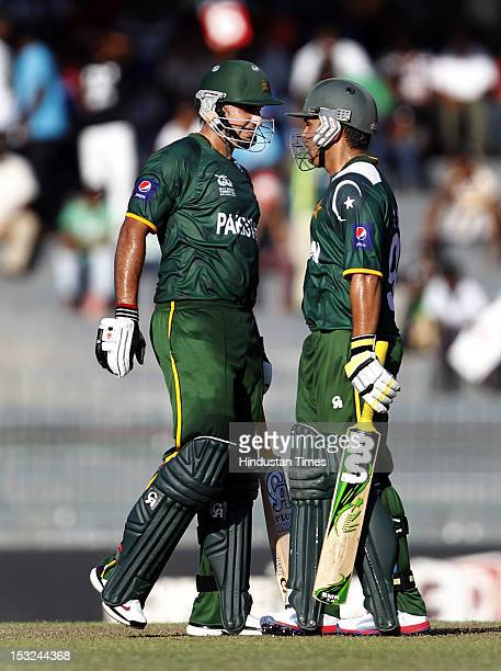 Kamran Akmal of Pakistan congratulates teammate Nasir Jamshed for his 50 during the ICC T20 World Cup Super Eight group 2 cricket match between...