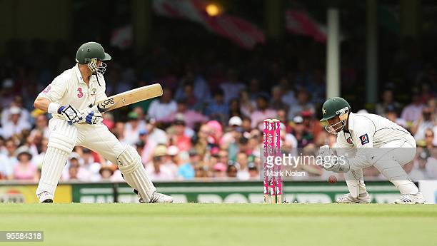 Kamran Akmal of Pakistan drops Michael Hussey of Australia during day three of the Second Test match between Australia and Pakistan at Sydney Cricket...