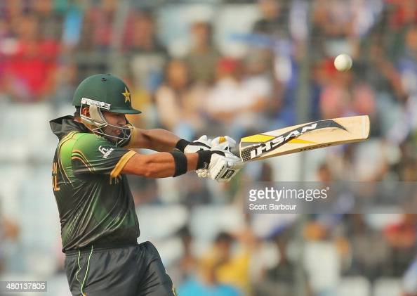 Kamran Akmal of Pakistan hits a boundary during the ICC World Twenty20 Bangladesh 2014 match between Australia and Pakistan at ShereBangla Mirpur...