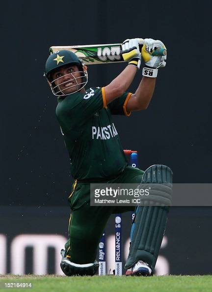 Kamran Akmal of Pakistan hits a six during the ICC T20 World Cup warm up match between India and Pakistan at the R Premadasa Stadium on September 17...