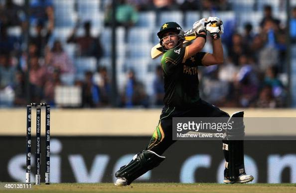 Kamran Akmal of Pakistan hits the bal ltowards the boundary during the ICC World Twenty20 Bangladesh 2014 match between Pakistan and Australia at...