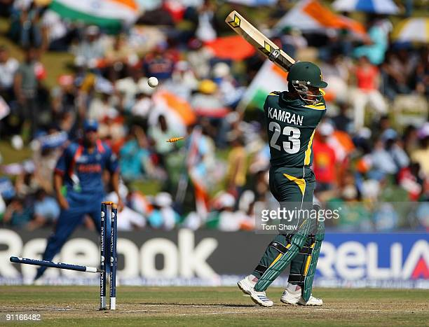 Kamran Akmal of Pakistan is bowled out during the ICC Champions Trophy group A match between India and Pakistan at Centurion on September 26 2009 in...