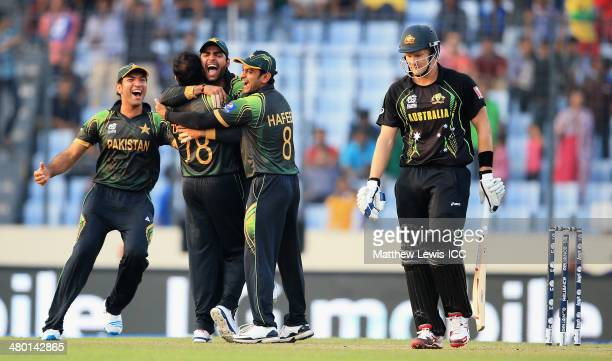 Kamran Akmal of Pakistan is congratulated by team mates after he caught Shane Watson of Australia off the bowling of Zulfiqar Babar during the ICC...