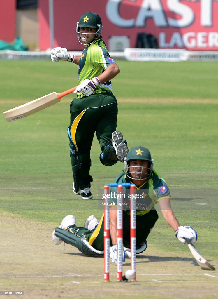 Kamran Akmal of Pakistan loks back to see if Younis Khan of Pakistan made his ground during the 5th Momentum ODI match between South Africa and Pakistan from Willowmoore Park on March 24, 2013 in Benoni, South Africa.