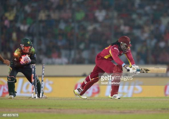 Kamran Akmal of Pakistan stumps Chris Gayle of the West Indies during the ICC World Twenty20 Bangladesh 2014 match between West Indies and Pakistan...
