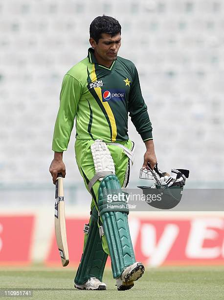 Kamran Akmal walks across the ground during a Pakistan nets session at the Punjab Cricket Association Stadium on March 28 2011 in Mohali India