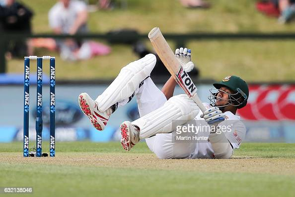 Kamrul Islam Rabbi of Bangladesh avoids a bouncher Tim Southee of New Zealand during day one of the Second Test match between New Zealand and...