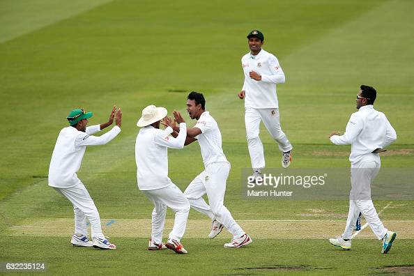 Kamrul Islam Rabbi of Bangladesh celebrates the wicket of Kane Williamson of New Zealand with team mates during day two of the Second Test match...