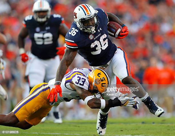 Kamryn Pettway of the Auburn Tigers attempts to break this tackle by Jamal Adams of the LSU Tigers at JordanHare Stadium on September 24 2016 in...