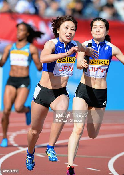 Kana Ichikawa is passed the button from Mayumi Watanabe of Japan during the Women's 4x100m Relay during the Seiko Golden Grand Prix Tokyo 2014 at...