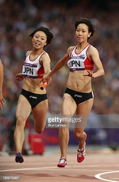 Kana Ichikawa of Japan passes the relay baton to Chisato Fukushima of Japan during the Women's 4 x 100m Relay Round 1 on Day 13 of the London 2012...