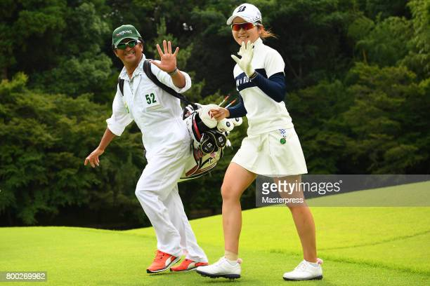 Kana Mikashima and her caddie of Japan smiles during the third round of the Earth Mondamin Cup at the Camellia Hills Country Club on June 24 2017 in...