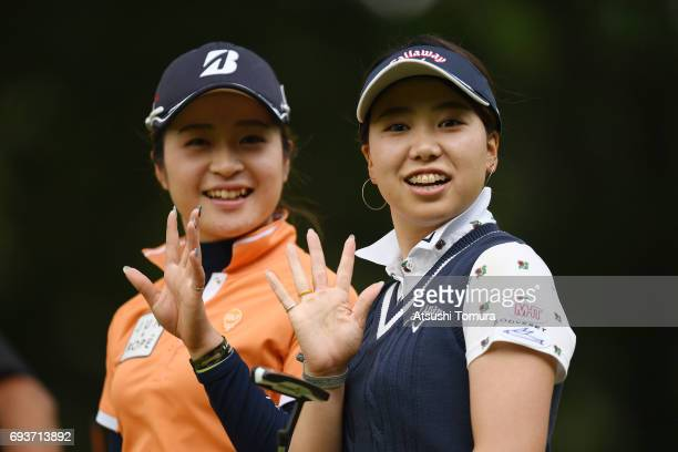 Kana Mikashima of Japan and Kana Taneda of Japan smile during the first round of the Suntory Ladies Open at the Rokko Kokusai Golf Club on June 8...