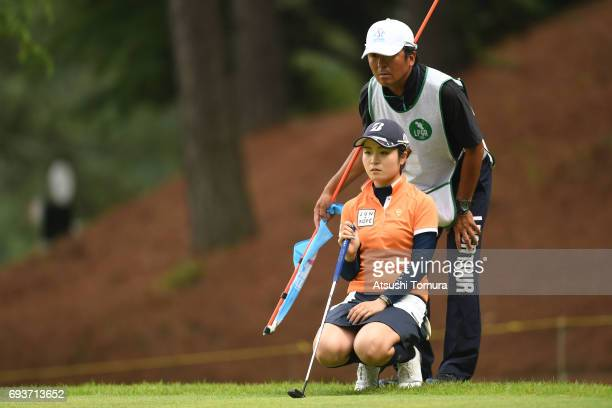 Kana Mikashima of Japan lines up her putt on the 1st hole during the first round of the Suntory Ladies Open at the Rokko Kokusai Golf Club on June 8...
