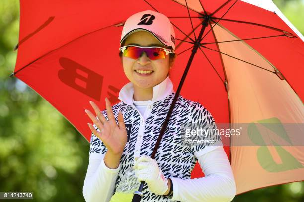 Kana Mikashima of Japan smiles during the first round of the Samantha Thavasa Girls Collection Ladies Tournament at the Eagle Point Golf Club on July...