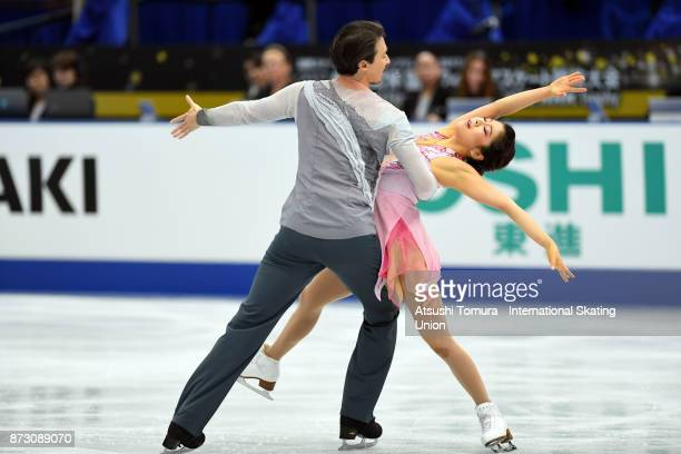 Kana Muramoto and Chris Reed of Japan compete in the Ice dace free dance during the ISU Grand Prix of Figure Skating at Osaka municipal central...