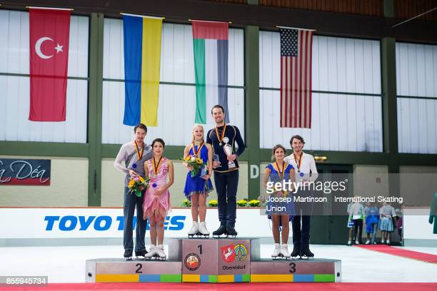 Kana Muramoto and Chris Reed of Japan Penny Coomes and Nicholas Buckland of Great Britain Kavita Lorenz and Joti Polizoakis of Germany pose in the...