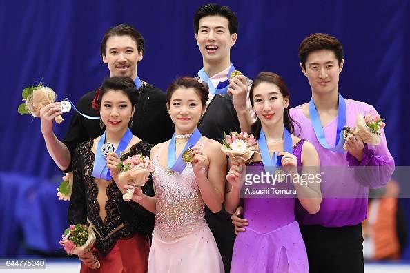 Kana Muramoto and Chris Reed of Japan Shiyue Wang and Xinyu Liu of China Hong Chen and Yan Zhao of China pose with their medals during the award...
