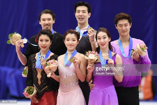 Kana Muramoto and Chris Reed of Japan Shiyue Wang and Xinyu Liu of China Hong Chen and Yan Zhao of China pose with their medals during the award...