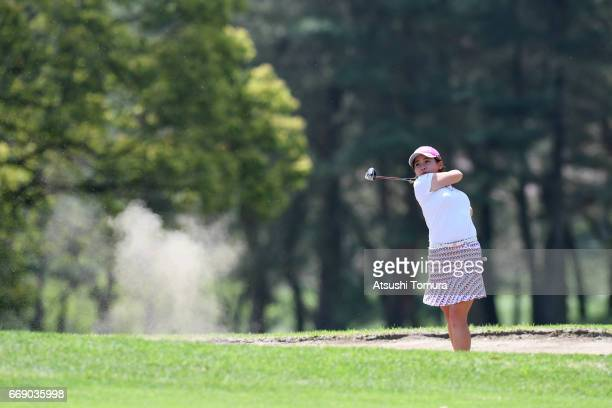 Kana Nagai of Japan hits her second shot on the 9th hole during the final round of the KKT Cup Vantelin Ladies Open at the Kumamoto Airport Country...