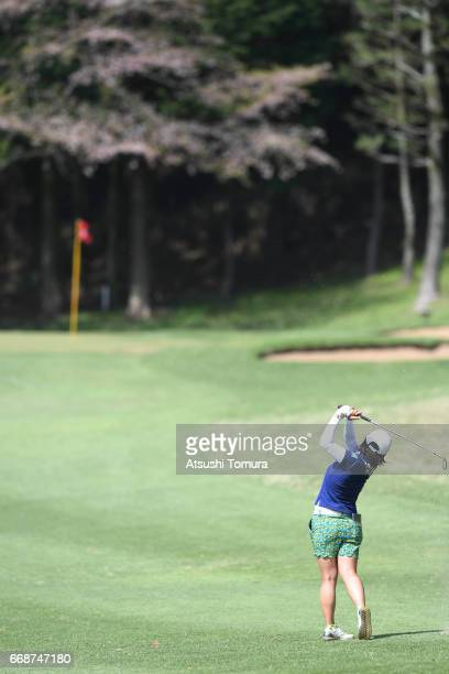 Kana Nagai of Japan hits her third shot on the 14th hole during the second round of the KKT Cup Vantelin Ladies Open at the Kumamoto Airport Country...