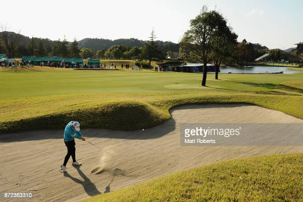 Kana Nagai of Japan hits out of the bunker on the 18th hole during the first round of the Itoen Ladies Golf Tournament 2017 at the Great Island Club...