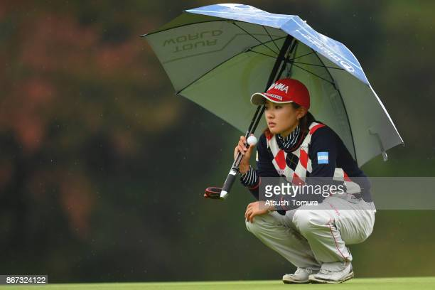 Kana Nagai of Japan lines up her putt on the 17th green during the second round of the Higuchi Hisako Ponta Ladies at the Musashigaoka Golf Course on...