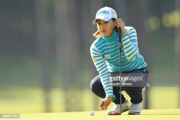 Kana Nagai of Japan lins up her putt on the 18th hole during the first round of the Higuchi Hisako Ponta Ladies at the Musashigaoka Golf Course on...