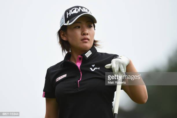 Kana Nagai of Japan watches her tee shot on the 10th hole during the first round of the HokennoMadoguchi Ladies at the Fukuoka Country Club Wajiro...