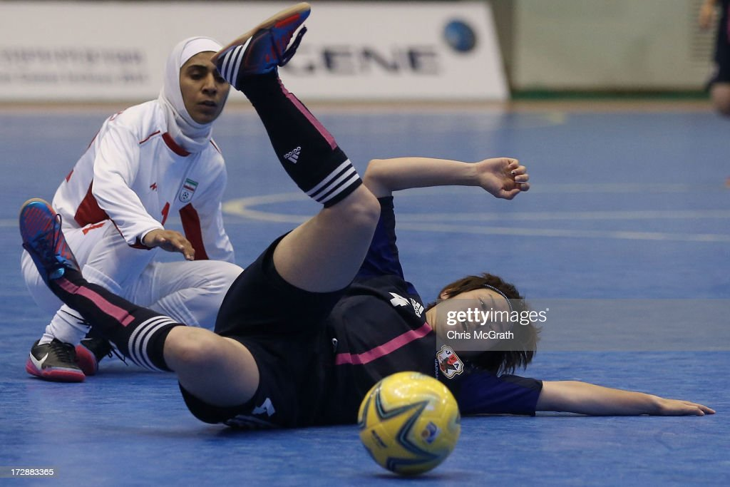 Kana Shibahara #4 of Japan clears the ball from Zarei Fahimeh #12 of Iran during the Women's Futsal Gold Medal match between Iran and Japan at Songdo Global University Campus Gymnasium during day seven of the 4th Asian Indoor & Martial Arts Games on July 5, 2013 in Incheon, South Korea.