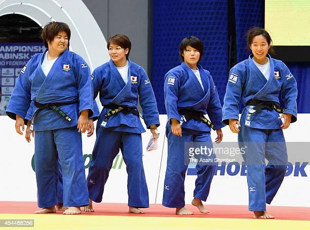 Kanae Yamabe Miku Tashiro Ai Shishime and Yuki Hashimoto show smiles after winning the bronze in Women's Team during the 2014 Chelyabinsk Judo World...
