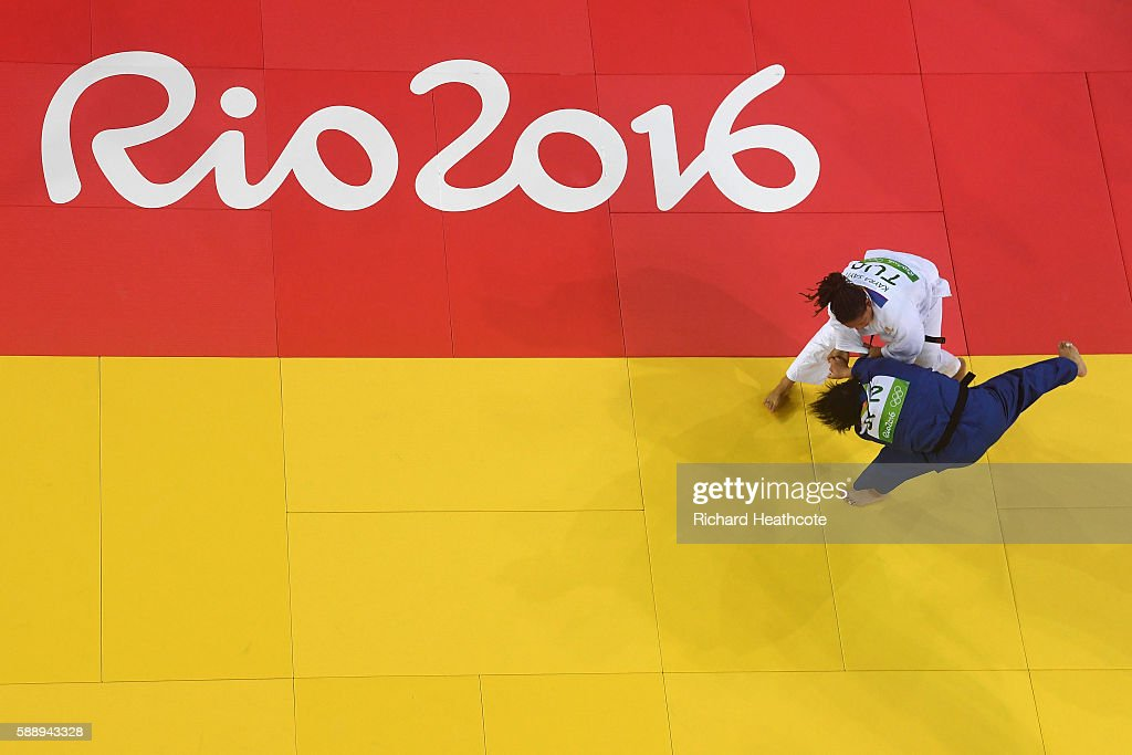 Kanae Yamabe of Japan and Kayra Sayit of Turkey compete during the Women's 78kg Judo contest on Day 7 of the Rio 2016 Olympic Games at Carioca Arena...