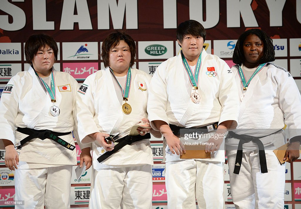 Kanae Yamabe of Japan, (Gold) Megumi Tachimoto of Japan, (Bronze) Qian Qin of China and (Bronze) <a gi-track='captionPersonalityLinkClicked' href=/galleries/search?phrase=Idalys+Ortiz&family=editorial&specificpeople=5492242 ng-click='$event.stopPropagation()'>Idalys Ortiz</a> of Cuba stands on the podium at the women's +78kg medal ceremony during day three of the Judo Grand Slam at the on December 1, 2013 in Tokyo, Japan.