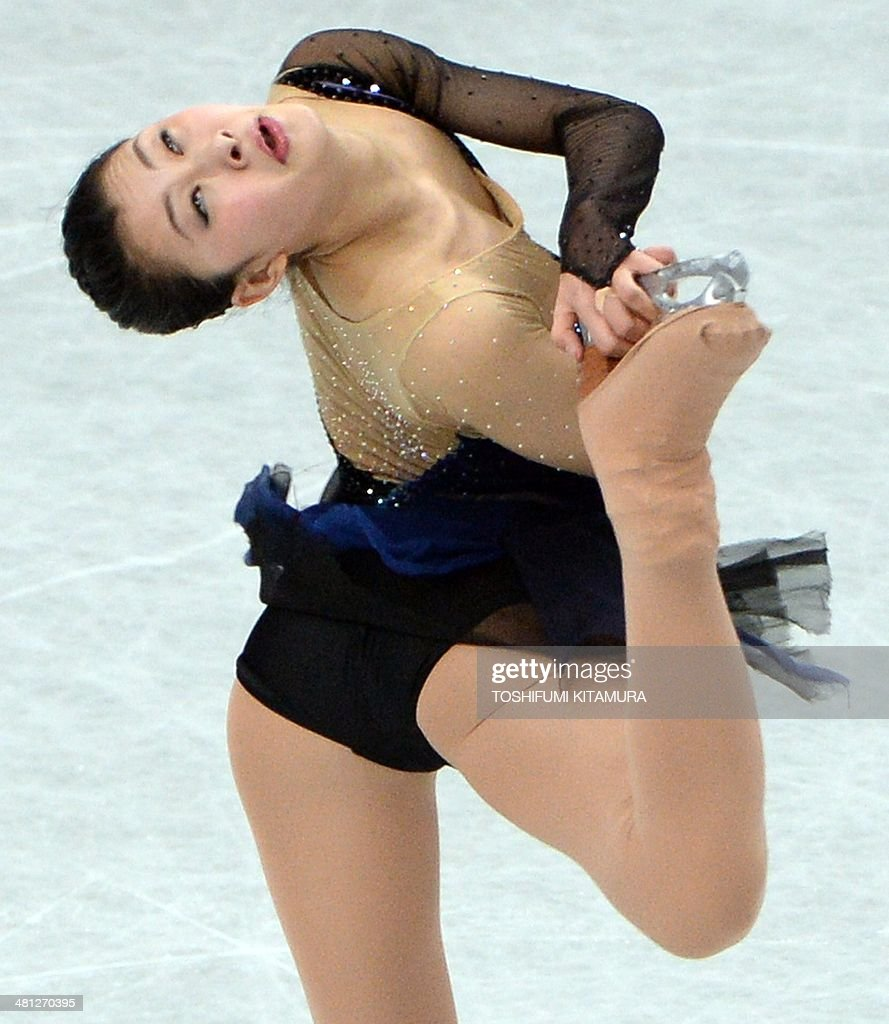 Kanako Murakami of Japan performs during her free skating in the women's singles at the world figure skating championships in Saitama on March 29, 2014. AFP PHOTO / TOSHIFUMI KITAMURA