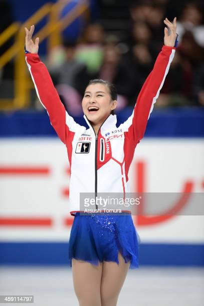 Kanako Murakami of Japan waves for fans during the All Japan Figure Skating Championships at Saitama Super Arena on December 23 2013 in Saitama Japan