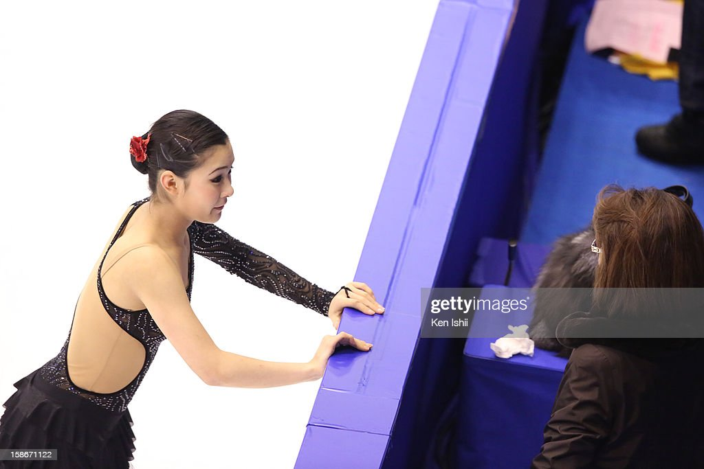 Kanako Murakami talks with her coach in the Women's Free Program during day three of the 81st Japan Figure Skating Championships at Makomanai Sekisui Heim Ice Arena on December 23, 2012 in Sapporo, Japan.