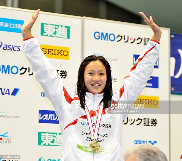 Kanako Watanabe celebrates on the podium after winning the Women's 200m Individual Medley during day three of the Japan Open at Sagamihara Green Pool...