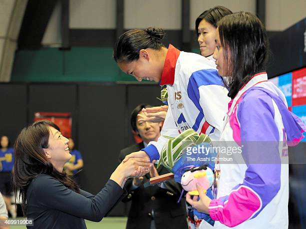 Kanako Watanabe shakes hands with Barcelona Olympic gold medalist Kyoko Iwasaki on the podium after winning the Women's 200m Breaststroke final...