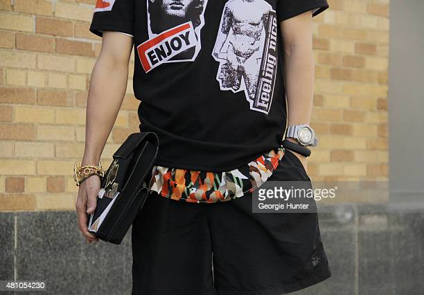 Kaname Morakami seen at Skylight Clarkson Sq outside the Perry Ellis show wearing top by Christopher Shannon shirt underneath by Topman shorts by...