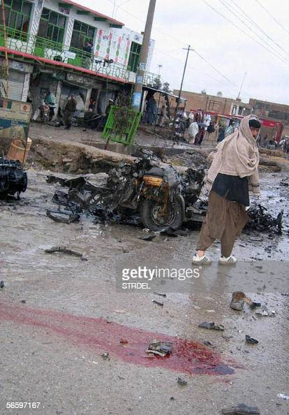 Afghan men survey the damage left in the wake of a suicide bomb attack in Kandahar 15 January The attack on a military convoy killed three people...