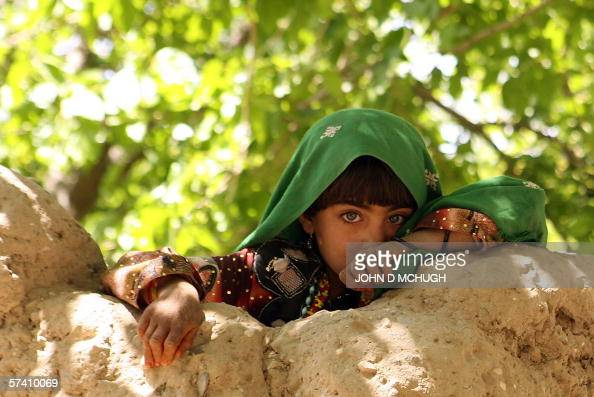 An Afghan child watches as members of the 1st Princess Patricia's Canadian Light Infantry leave after searching a village in northern Kandahar 24...