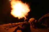 British soldiers from 2 Squadron Royal Air Force Regiment fire illumination flares from a mortar at Kandahar Air Field 04 November 2006 The RAF...
